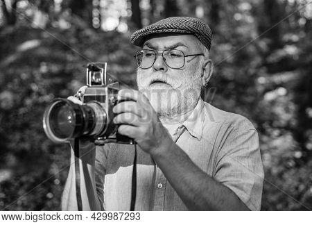 Manual Settings. Pension Hobby. Experienced Photographer. Old Man Shoot Nature. Cameraman Retirement