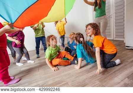 Organised Team Building Games For Kids Using Rainbow Canopy