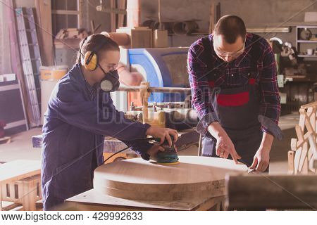 Young Apprentice Learning To Polish Wooden Elements