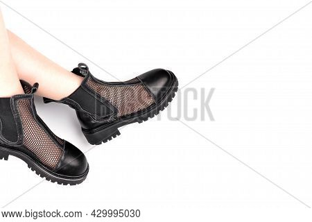 Stylish Black Women's Mesh Boots With An Elastic Band And A Massive Sole On The Feet On A White Back