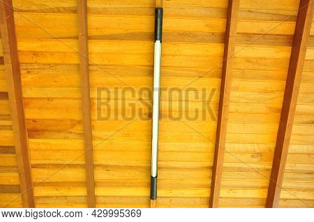 Wood. Wooden Ceiling With Installed Led Light, Beams And Rafters In Symmetry, In Natural Wood Color,