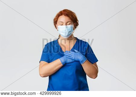 Medical Workers, Covid-19 Pandemic, Coronavirus Concept. Happy And Dreamy Redhead Female Nurse, Midd