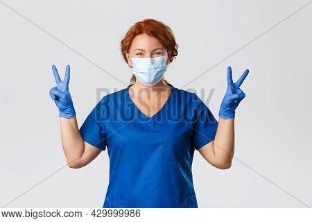 Medical Workers, Covid-19 Pandemic, Coronavirus Concept. Optimistic Smiling Redhead Female Doctor, P
