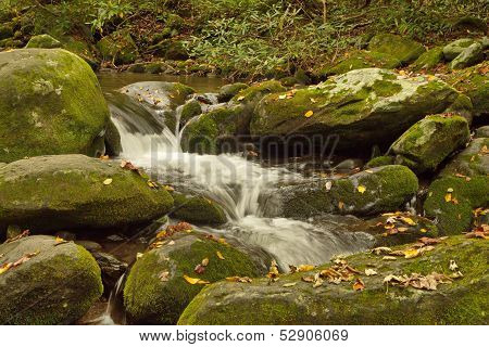 water cascading off rocks in the Smoky Mountains during Autumn
