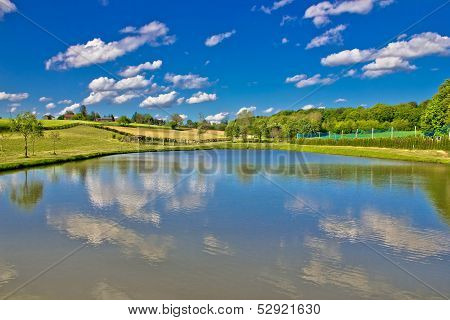 Idyllic Lake In Green Landscape