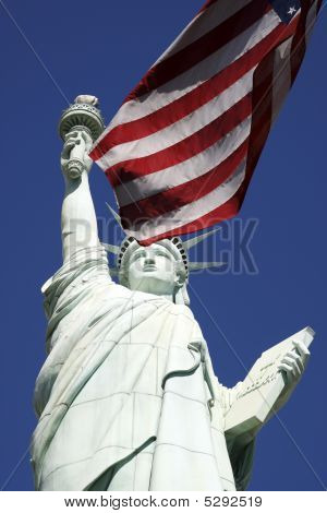 Statue Of Liberty And The American Flag United States