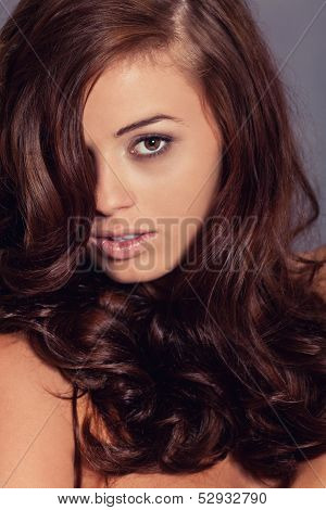 Young Attractive Bunette Woman With Glossy Shiny Hair