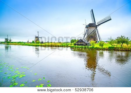 Windmills and water canal in Kinderdijk Holland or Netherlands. Unesco world heritage site. Europe. poster