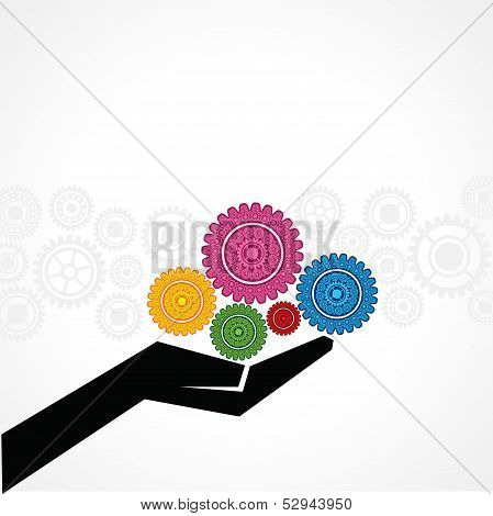 Businessman holds gears on his hand stock vector