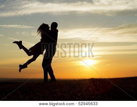 Young couple having fun at sunset