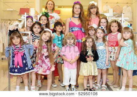 MOSCOW - MAY 18: Fashion models of Polina Golub in Yakimanka, on May 18, 2013 in Moscow, Russia.  Polina Golub is exclusive designer of children clothes.
