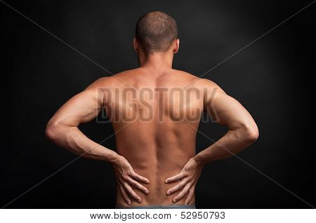 Strong Man Holding His Back With Hands