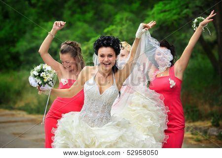Happy bridesmaids enjoying with bride