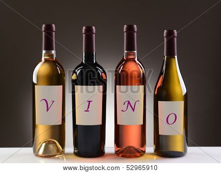 Four Wine Bottles with their labels spelling out the word VINO, on a light to dark gray background. Wines include: Cabernet Sauvignon, Chardonnay, Sauvignon Blanc, and White Zinfandel.