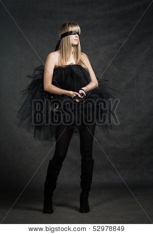Blindfolded girl waiting. She weared black tutu skirt