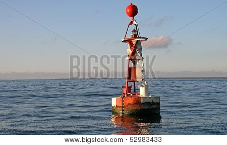 Floating Red And White Buoy With Sphere Shape On Top