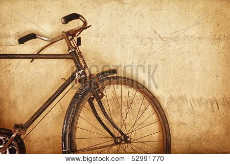 Old-fashioned Rusty Bicycle Near The Wall