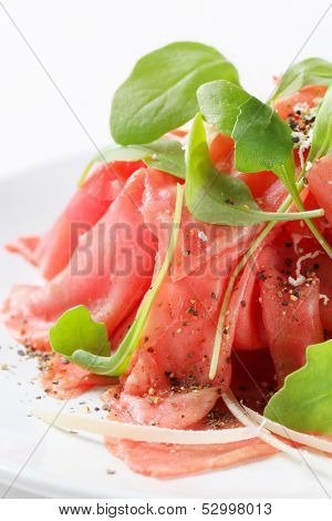 Appetizing prosciutoo salad decorated fresh basil