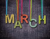 March letters hanging strings with blue sackcloth background. poster