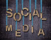 Social Media etters hanging strings with blue sackcloth background. poster