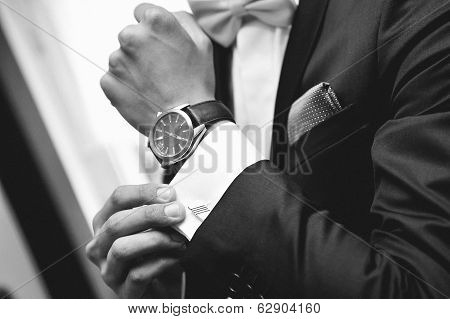 Man with suit and watch on hand