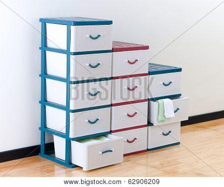 Stacks of plastic drawers