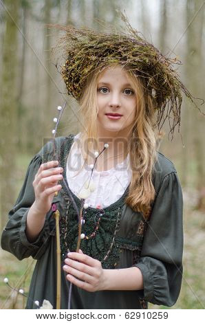 Portrait Of A Girl In A Folk  Medieval Style With A Circlet Of Flowers Touching Willow Branch