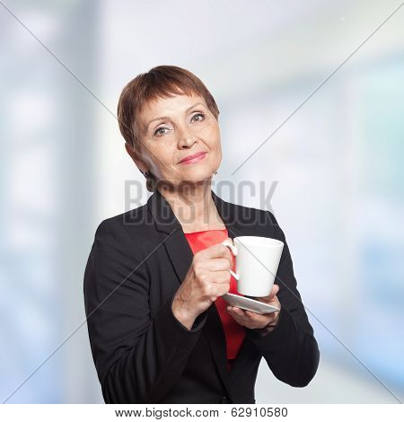 Attractive Woman 50 Years With Cup Of  Coffee