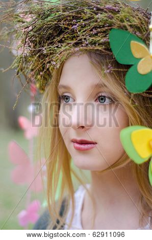 Close Up Portrait Of A Folk Style Beautiful Girl In A Circlet Of Flowers