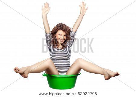 Funny Girl Sitting In A Basin.