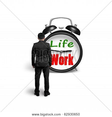 Man facing alarm clock with life and work face in white background poster
