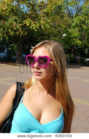 Young Girl In Sunglasses.