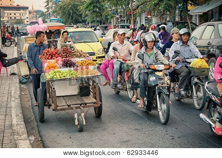 Phnom Penh, Cambodia - 29 Dec 2013: Heavy Traffic Through The City Streets In The Evening. The Main
