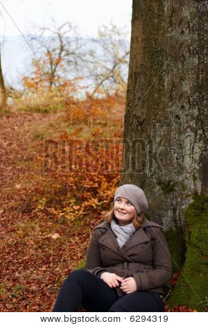Fall - Cute Young Woman Looking Up At Copyspace