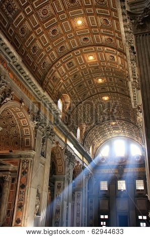 VATICAN - AUGUST 4: Interior of Saint Peters Basilica with crepuscular rays on August 4, 2011 in Vat
