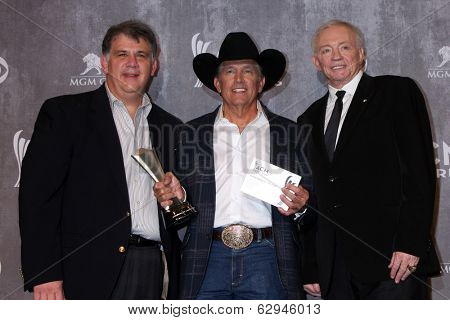 LAS VEGAS - APR 6:  Bob Romero, George Strait, Jerry Jones at the 2014 Academy of Country Music Awards - Arrivals at MGM Grand Garden Arena on April 6, 2014 in Las Vegas, NV