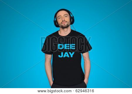 man dj wearing headphones on blue enjoying the music