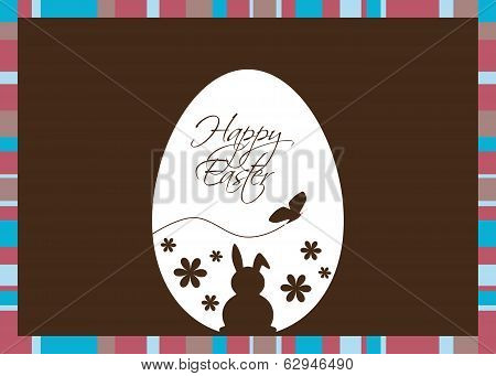 Vector Easter Egg with Greeting on a Brown Background