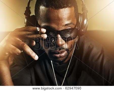 dj smoking and wearing sunglasses