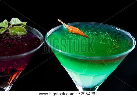 Molecular mixology - two cocktails with  caviar in martini glasses