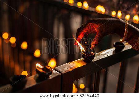 Lighting up Diwali lights. India