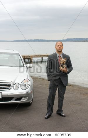 Ethnic Business Man And Yorkshire Terrier Dog At Lake