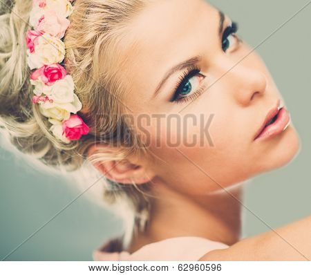 Beautiful young dreaming woman with chaplet
