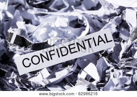 shredded paper tagged confidential, symbol photo for data destruction, banking secrecy and confidentiality