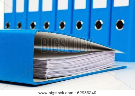 file folder with documents and documents. retention of contracts. poster