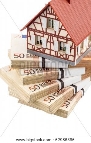 half-timbered house on euro banknotes, symbolic photo for home purchase, financing, building society