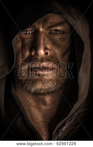 Portrait of a courageous warrior wanderer in a black cloak. Historical fantasy. Halloween.