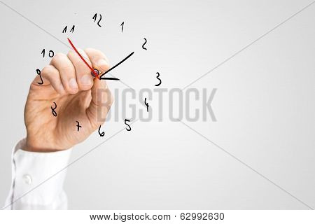 Man Adding A Second Hand To A Hand-drawn Clock