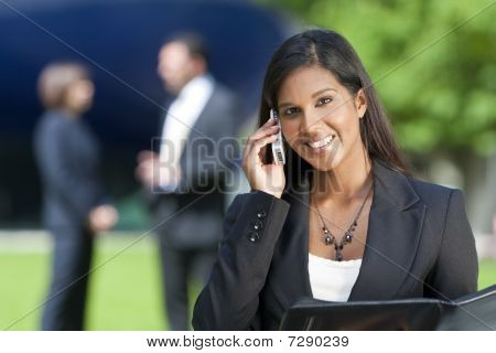 Beautiful Young Indian Asian Woman On Her Cell Phone