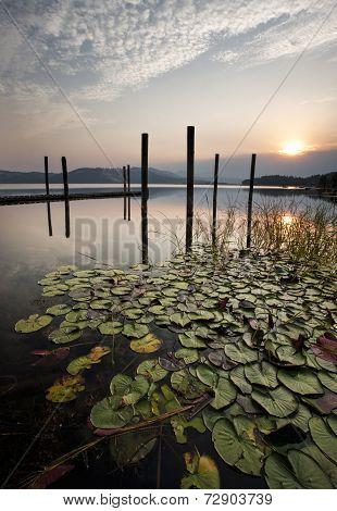 Beautiful Sunrise Over Calm Lake.